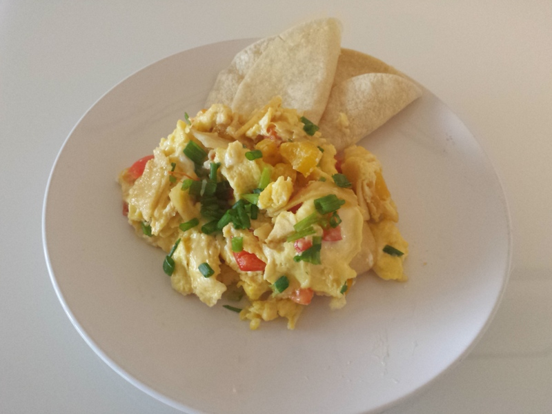 Fluffy eggs scrambled with crisp fried tortillas, sautéed peppers ...